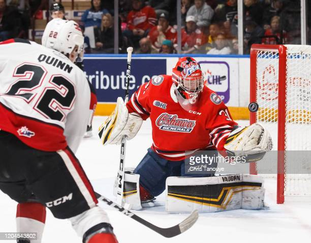 Jordan Kooy of the Oshawa Generals makes a glove save in the second period during an OHL game against the Ottawa 67's at the Tribute Communities...