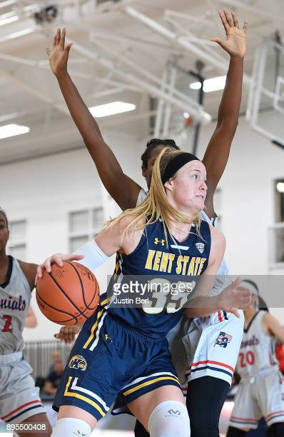 Jordan Korinek of the Kent State Golden Flashes goes to the basket against Mikalah Mulrain of the Robert Morris Colonials in the second half during...