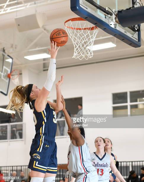 Jordan Korinek of the Kent State Golden Flashes goes to the basket against Nneka Ezeigbo of the Robert Morris Colonials in the second half during the...
