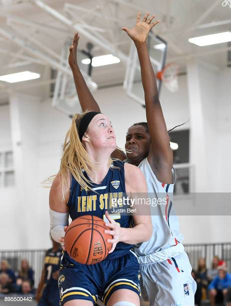 Jordan Korinek of the Kent State Golden Flashes looks to goes to the basket against Mikalah Mulrain of the Robert Morris Colonials in the second half...