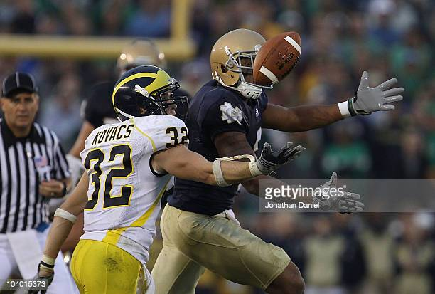 Jordan Kovacs of the Michigan Wolverines breaks up a pass intended for Michael Floyd of the Notre Dame Fighting Irish at Notre Dame Stadium on...