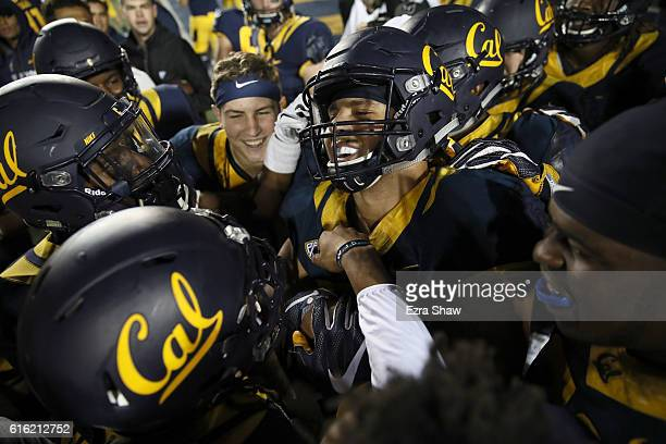 Jordan Kunaszyk of the California Golden Bears celebrates with teammates after he intercepted the ball in overtime to beat the Oregon Ducks at...