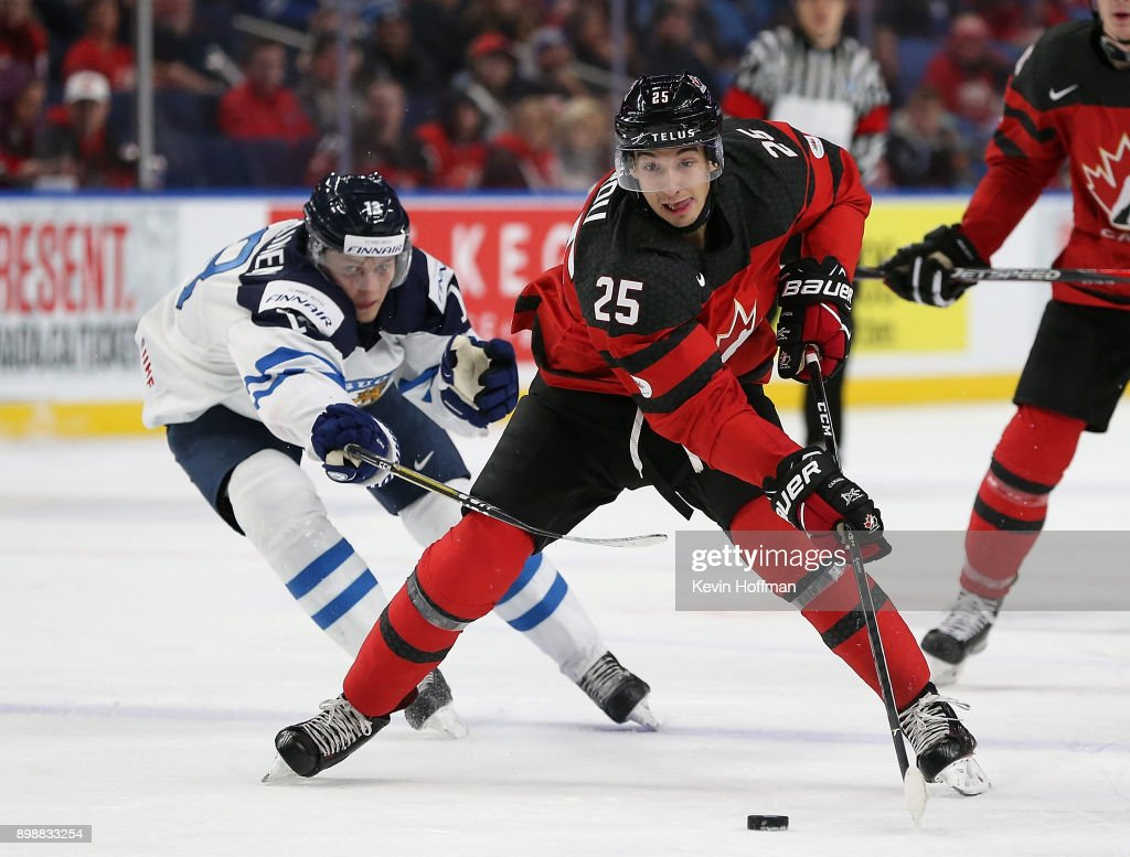 Jordan Kyrou #25 of Canada skates up ice with the puck during the third period as Kristian Vesalainen #13 of Finland pursues at KeyBank Center on December 26, 2017 in Buffalo, New York. Canada beat Finland 4-2.