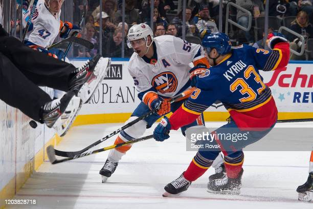 Jordan Kyrou of the St Louis Blues and Johnny Boychuk of the New York Islanders battle at Enterprise Center on February 27 2020 in St Louis Missouri