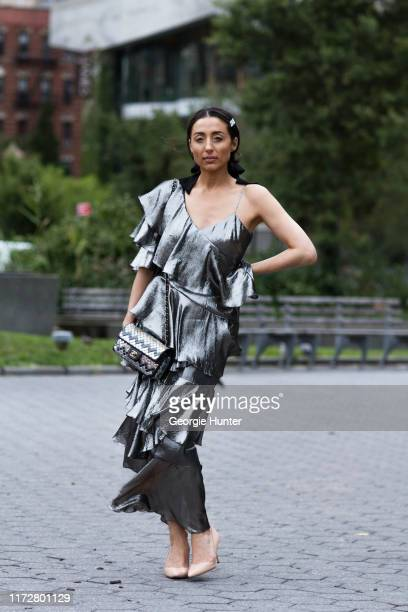 Jordan Landes-Brenman wearing silver metallic dress with cascading layered frills by Flor et.al and tan heels by Sarah Flint on September 06, 2019 in...