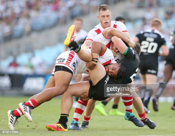 Jordan Lane of Hull is tackled by Hame Sele of the Dragons during the NRL trial match between the St George Illawarra Dragons and Hull at ANZ Stadium...