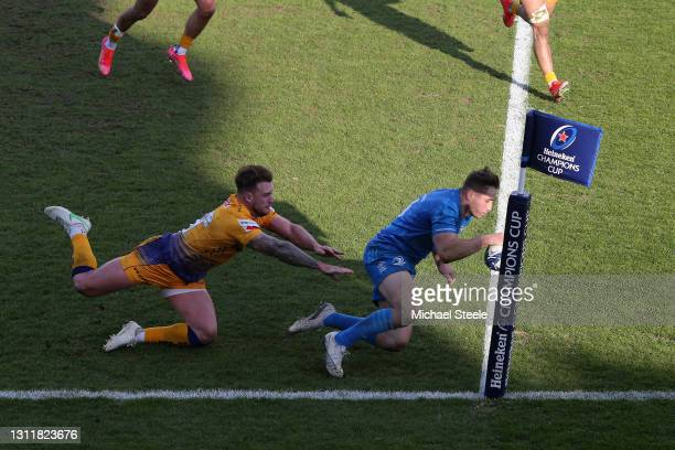 Jordan Larmour of Leinster scores their second try under pressure from Stuart Hogg of Exeter Chiefs during the Heineken Champions Cup Quarter Final...
