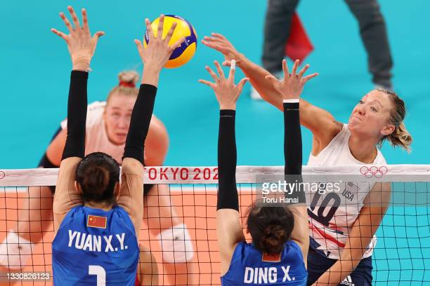Jordan Larson of Team United States hits against Xinyue Yuan of Team China during the Women's Preliminary - Pool B volleyball on day four of the...