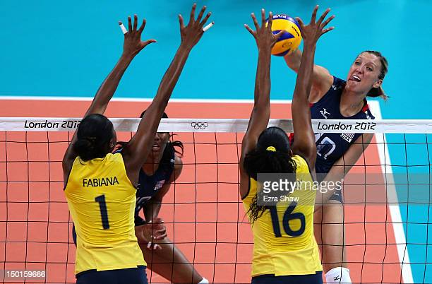 Jordan Larson of United States goes up for the spike against Fernanda Rodrigues and Fabiana Claudino of Brazil during the Women's Volleyball gold...
