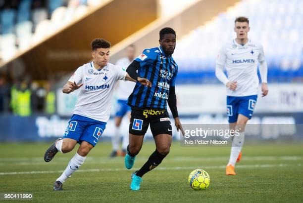 Jordan Larsson of IFK Norrkoping and Abdul Razak of IK Sirius FK competes for the ball during the Allsvenskan match between IFK Norrkoping and IK...