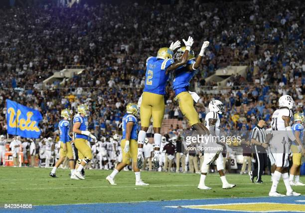 Jordan Lasley and UCLA Theo Howard celebrate after a touchdown in the fourth quarter during a college football game between the Texas AM Aggies and...