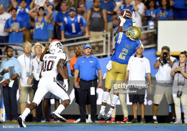 Jordan Lasley catches the game winning pass for a touchdown against Texas AM Myles Jones in the fourth quarter during a college football game between...