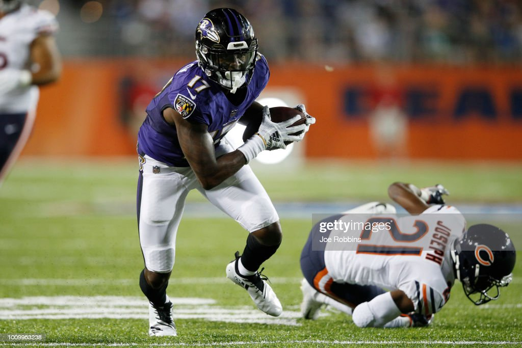 Jordan Lasley #17 of the Baltimore Ravens breaks a tackle after a reception against Michael Joseph #21 of the Chicago Bears in the third quarter of the Hall of Fame Game at Tom Benson Hall of Fame Stadium on August 2, 2018 in Canton, Ohio.