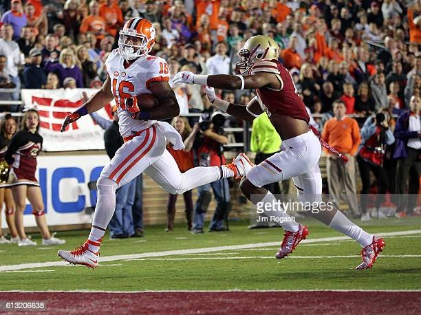 Jordan Leggett of the Clemson Tigers beats the defense of Gabriel McClary of the Boston College Eagles for a touchdown in the first quarter during...