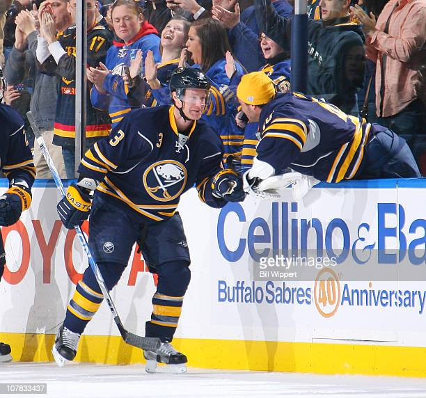 Jordan Leopold of the Buffalo Sabres celebrates a goal with Patrick Lalime against the Florida Panthers at HSBC Arena on December 23, 2010 in...