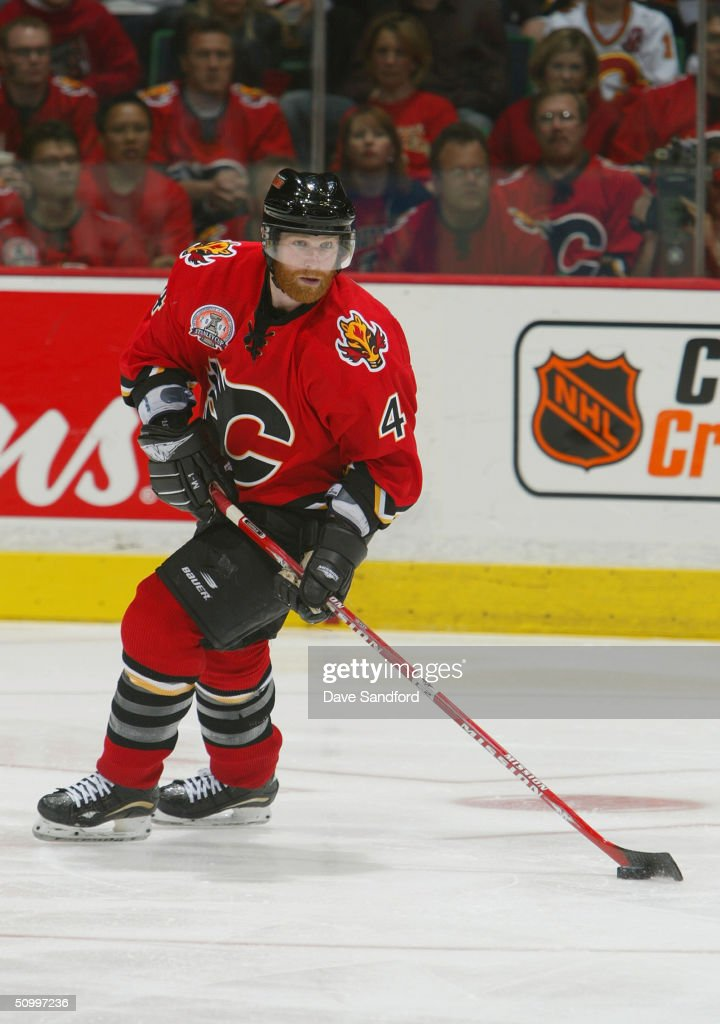 Jordan Leopold #4 of the Calgary Flames looks to make an outlet pass against the Tampa Bay Lightning in Game Four of the NHL Stanley Cup Finals on May 31, 2004 at the Pengrowth Saddledome in Calgary, Canada. The Lightning defeated the Flames 1-0.