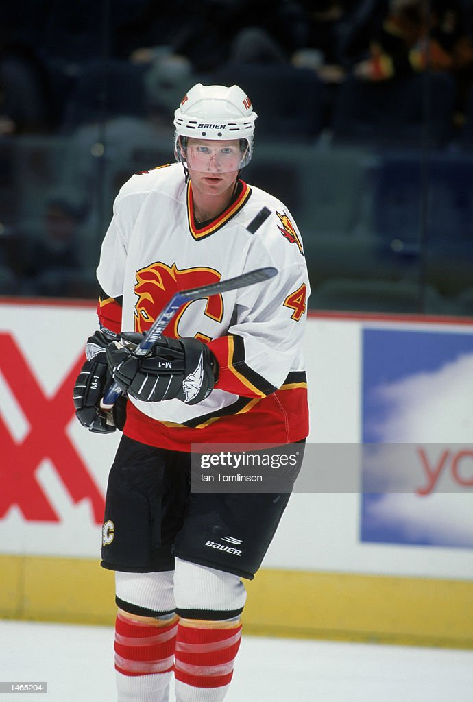Jordan Leopold Of The Calgary Flames Points With His Hockey Stick