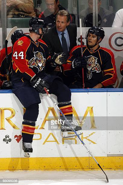 Jordan Leopold of the Florida Panthers chats with Assistant Coach Mike Kitchen on the bench during a break in the action against the New York...