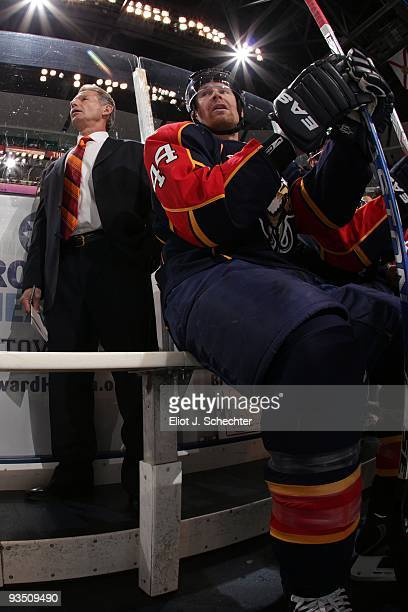 Jordan Leopold of the Florida Panthers sits on the bench and watches the action with Assistant Coach Mike Kitchen against the New York Rangers at the...