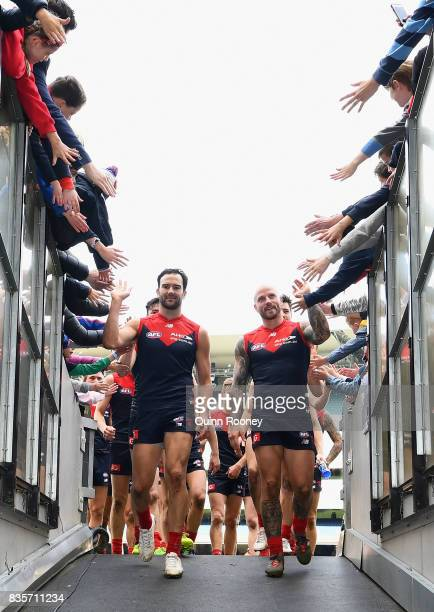 Jordan Lewis and Nathan Jones of the Demons high five fans after winning the round 22 AFL match between the Melbourne Demons and the Brisbane Lions...