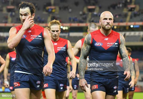 Jordan Lewis and Nathan Jones of the Demons look dejected after losing the round nine AFL match between the Melbourne Demons and the North Melbourne...