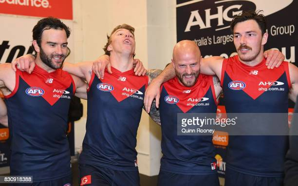 Jordan Lewis James Harmes Nathan Jones and Michael Hibberd of the Demons sing the song in the rooms after winning the round 21 AFL match between the...