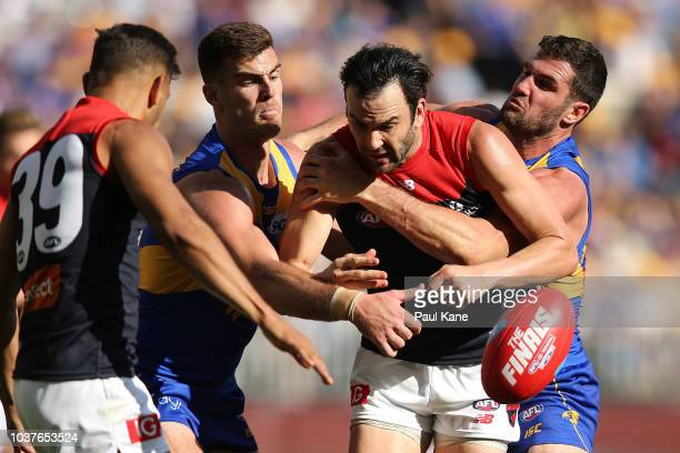 Jordan Lewis of the Demons gets tackled by Scott Lycett and Jack Darling of the Eagles during the AFL Preliminary Final match between the West Coast...