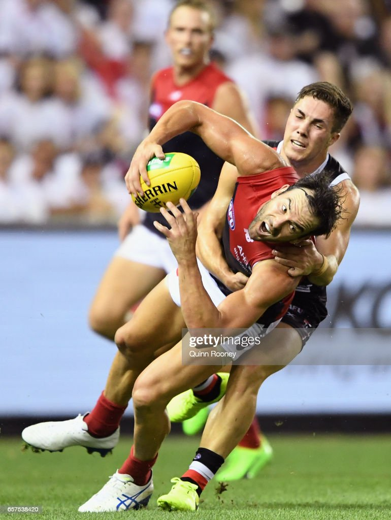 Jordan Lewis of the Demons is tackled by Jade Gresham of the Saints during the round one AFL match between the St Kilda Saints and the Melbourne Demons at Etihad Stadium on March 25, 2017 in Melbourne, Australia.