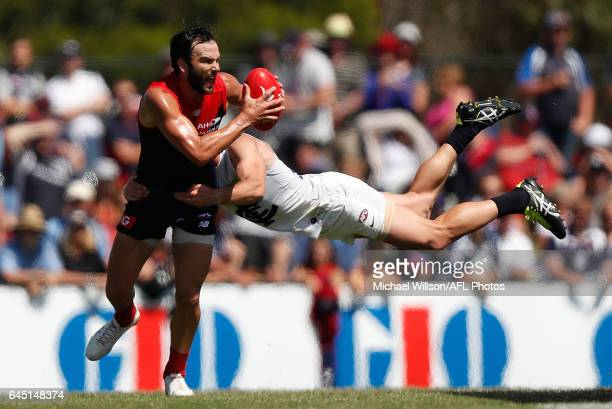 Jordan Lewis of the Demons is tackled by Sam Docherty of the Blues during the AFL 2017 JLT Community Series match between the Melbourne Demons and...