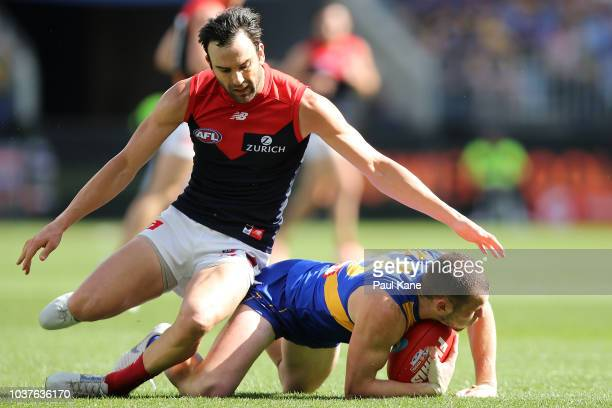 Jordan Lewis of the Demons tackles Daniel Venables of the Eagles during the AFL Preliminary Final match between the West Coast Eagles and the...
