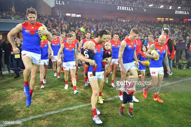 Jordan Lewis of the Demons walks onto the ground for his 300th AFL game during the round 19 AFL match between the Adelaide Crows and the Melbourne...