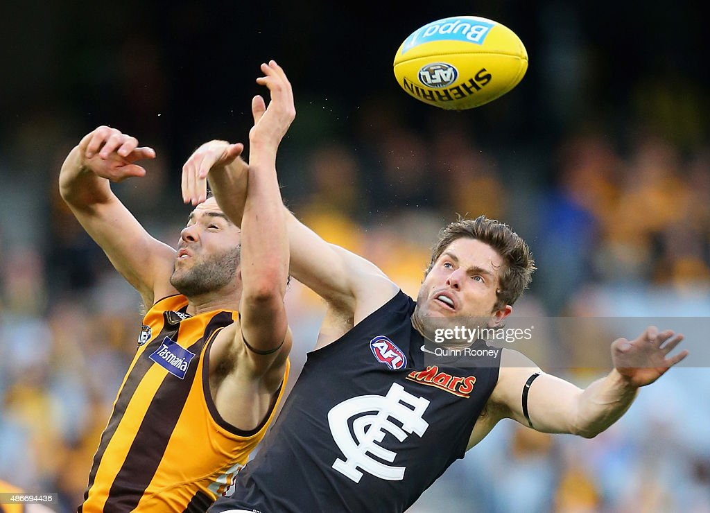 Jordan Lewis of the Hawks attempts to mark infront of Jason Tutt of the Blues during the round 23 AFL match between the Hawthorn Hawks and the Carlton Blues at Melbourne Cricket Ground on September 5, 2015 in Melbourne, Australia.