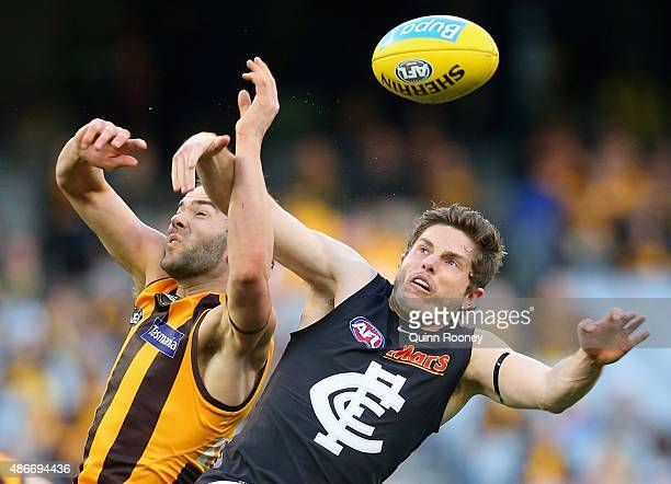 Jordan Lewis of the Hawks attempts to mark infront of Jason Tutt of the Blues during the round 23 AFL match between the Hawthorn Hawks and the...