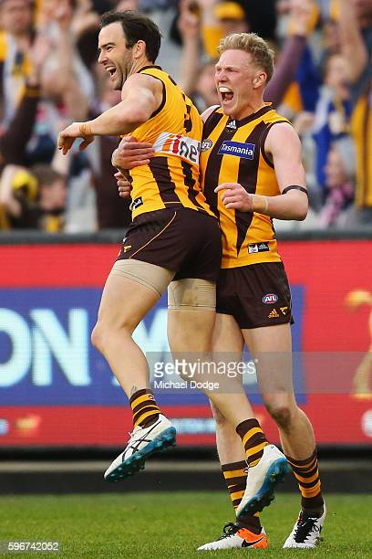 Jordan Lewis of the Hawks celebrates a goal with James Sicily during the round 23 AFL match between the Hawthorn Hawks and the Collingwood Magpies at...