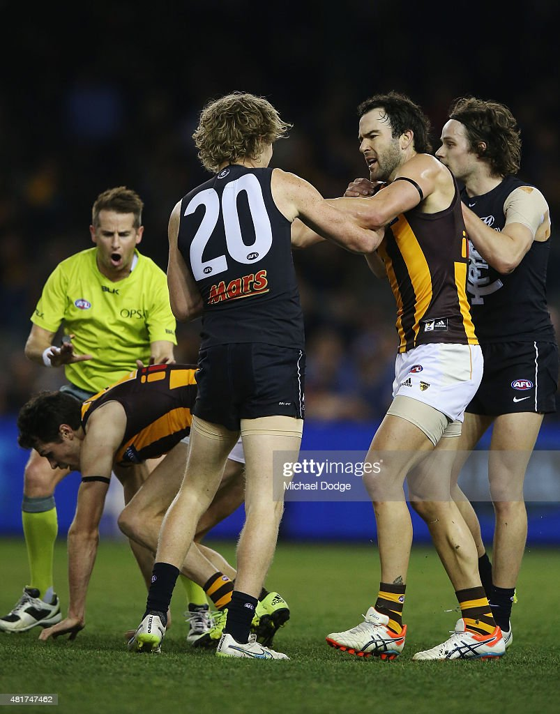 Jordan Lewis of the Hawks comes in to remonstrate with Nick Holman of the Blues (L) after he hit Luke Breust of the Hawks late with a forearm to the head during the round 17 AFL match between the Carlton Blues and the Hawthorn Hawks at Etihad Stadium on July 24, 2015 in Melbourne, Australia.
