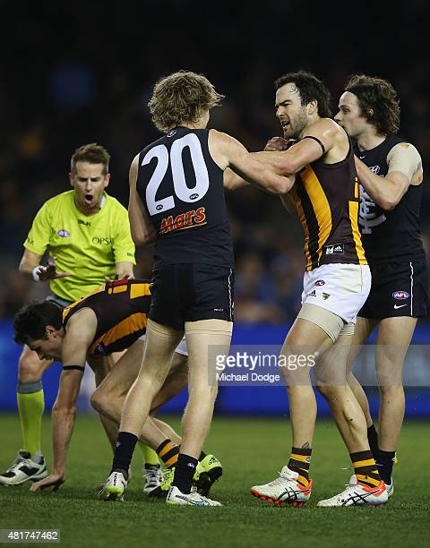 Jordan Lewis of the Hawks comes in to remonstrate with Nick Holman of the Blues after he hit Luke Breust of the Hawks late with a forearm to the head...
