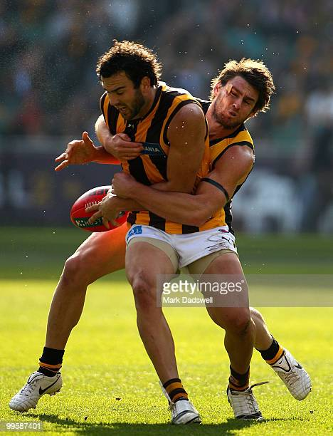 Jordan Lewis of the Hawks is tackled by Chris Newman of the Tigers during the round eight AFL match between the Richmond Tigers and the Hawthorn...
