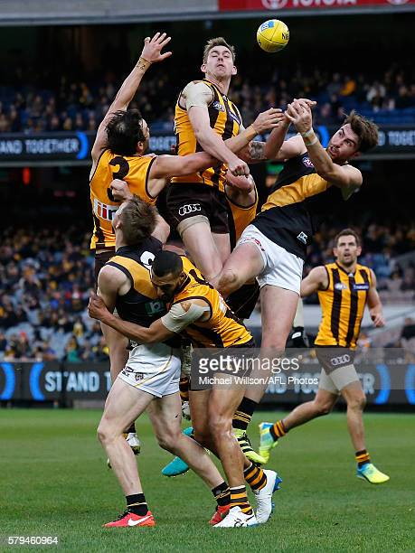 Jordan Lewis of the Hawks Jack Riewoldt of the Tigers Josh Gibson of the Hawks Kaiden Brand of the Hawks and Liam McBean of the Tigers compete for...