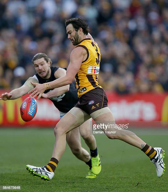 Jordan Lewis of the Hawks kicks a goal during the round 19 AFL match between the Hawthorn Hawks and the Carlton Blues at Aurora Stadium on July 30...
