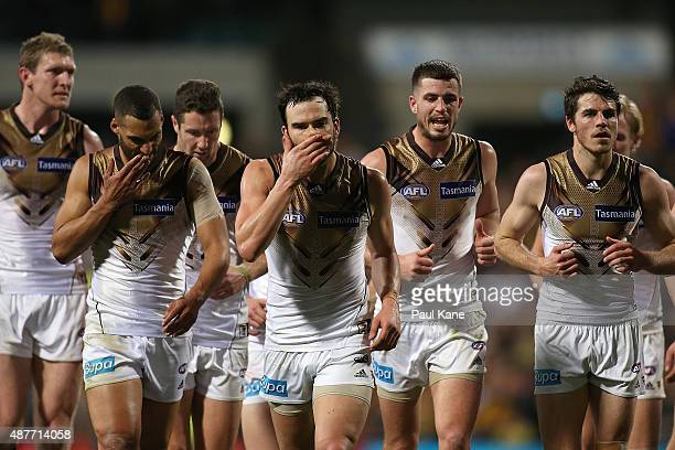 Jordan Lewis of the Hawks leads the team into the rooms at the half time break during the AFL Qualifying Final match between the West Coast Eagles...