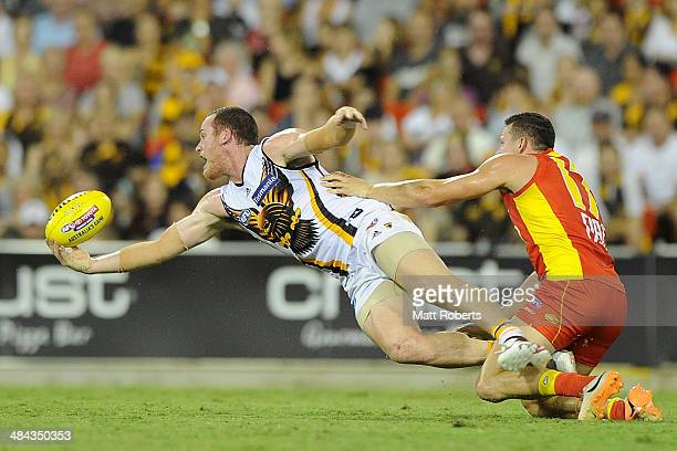 Jordan Lewis of the Hawks marks the ball during the round four AFL match between the Gold Coast Suns and the Hawthorn Hawks at Metricon Stadium on...