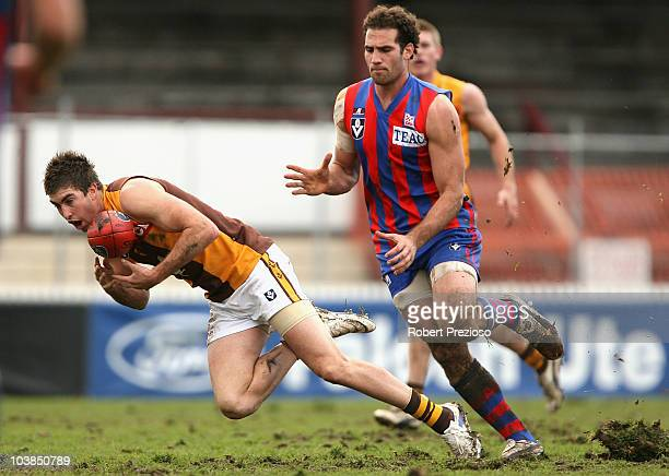 Jordan Lisle of the Hawks gathers the ball during the First VFL Semi Final match between Port Melbourne and the Box Hill Hawks at Teac Oval on...