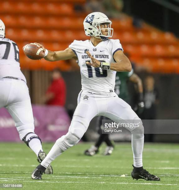 Jordan Love of the Utah State Aggies throws a pass downfield during the first half of the game against the Hawaii Rainbow Warriors at Aloha Stadium...