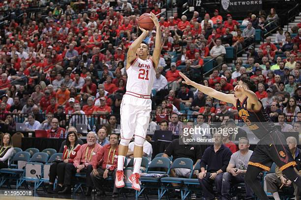 Jordan Loveridge of the Utah Utes shoots the ball for three over Bennie Boatwright of the USC Trojans during a quarterfinal game of the Pac12...