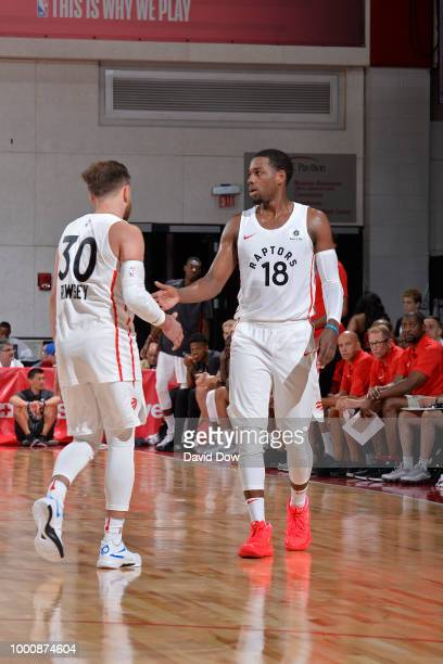 Jordan Loyd and Andrew Rowsey of the Toronto Raptors high five during the game against the Minnesota Timberwolves on July 8 2018 at the Cox Pavilion...