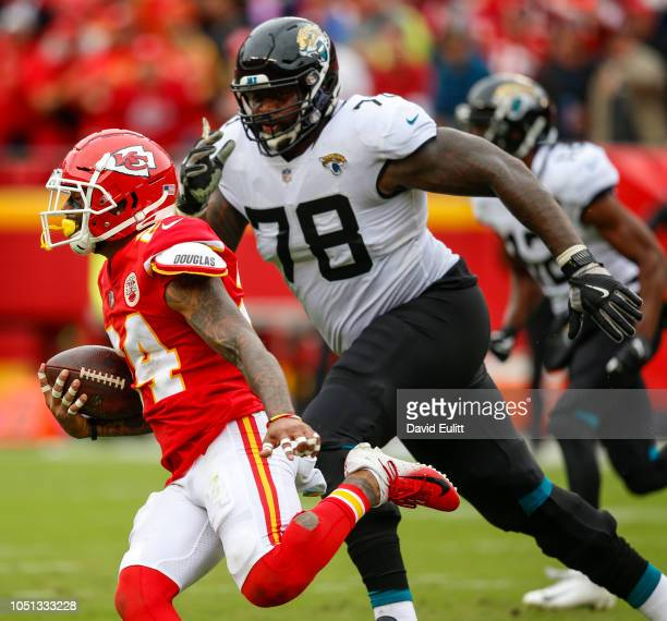 Jordan Lucas cornerback with the Kansas City Chiefs returned an fourth quarter interception 49 yards while being pursued by Jermey Parnell offensive...