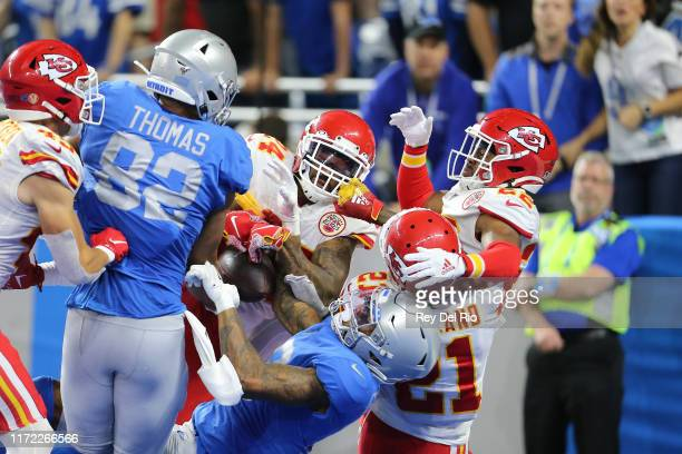 Jordan Lucas of the Kansas City Chiefs battles for the Hail Mary in the fourth quarter against Logan Thomas and Kenny Golladay of the Detroit Lions...