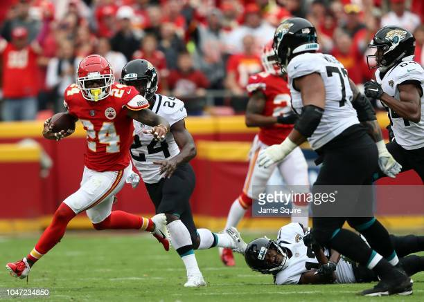 Jordan Lucas of the Kansas City Chiefs celebrates runs with the ball after intercepting a pass during the game against the Jacksonville Jaguars at...