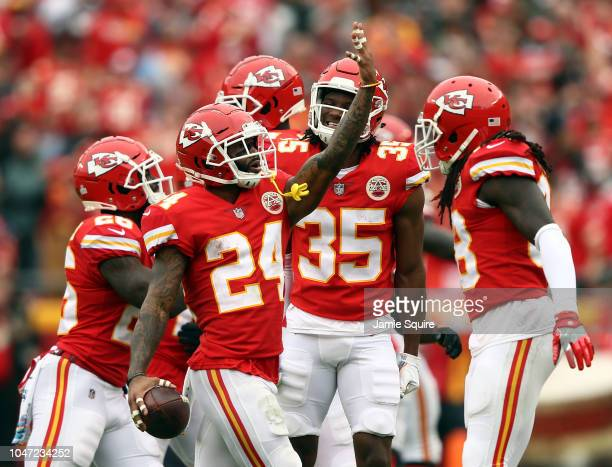 Jordan Lucas of the Kansas City Chiefs celebrates with teammates after intercepting a pass during the game against the Jacksonville Jaguars at...