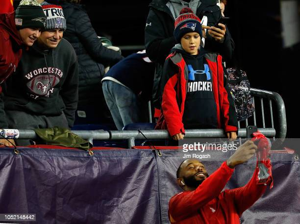 Jordan Lucas of the Kansas City Chiefs takes a photo with fans before a game with the New England Patriots at Gillette Stadium on October 14 2018 in...